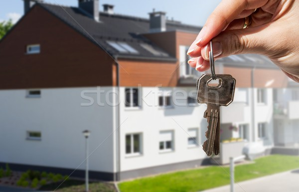 Woman's hand holding keys to new house Stock photo © simpson33