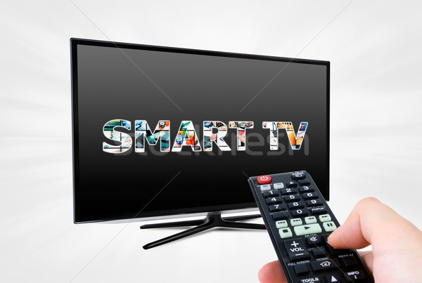 Hand afstandsbediening moderne smart tv Stockfoto © simpson33