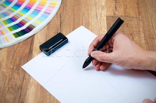 Graphic designer working with modern digitized pen Stock photo © simpson33