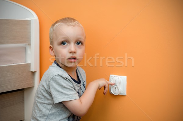 Child near to the socket. Electrical security of ac power for ba Stock photo © simpson33