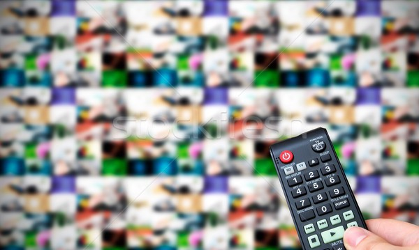 Remote control. Multiple images gallery panel in background Stock photo © simpson33