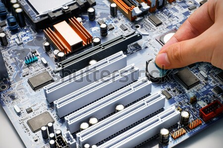 Hand install battery to PC motherboard Stock photo © simpson33