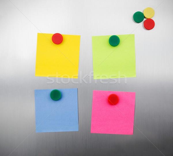Stock photo: Coloured notes and magnets on inox metallic fridge