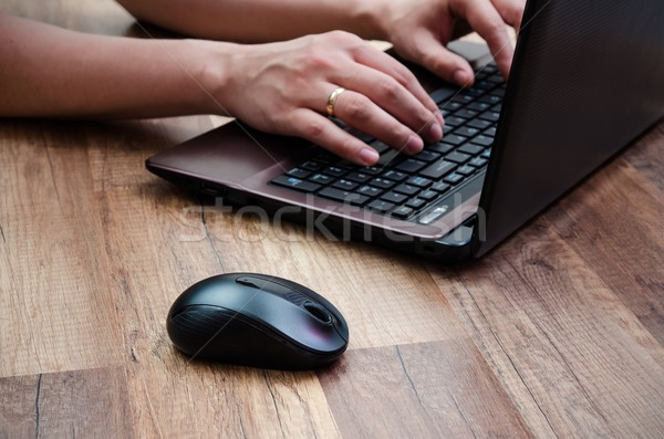 Man working with laptop on wooden background Stock photo © simpson33