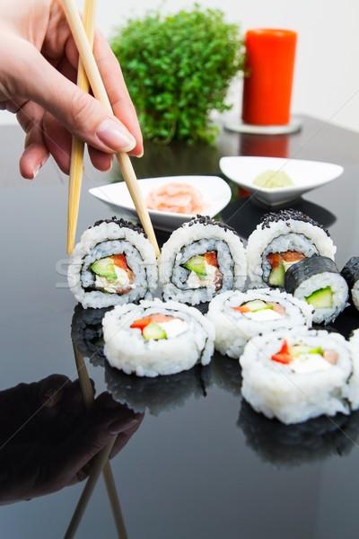 Mano stick maki sushi set Foto d'archivio © simpson33