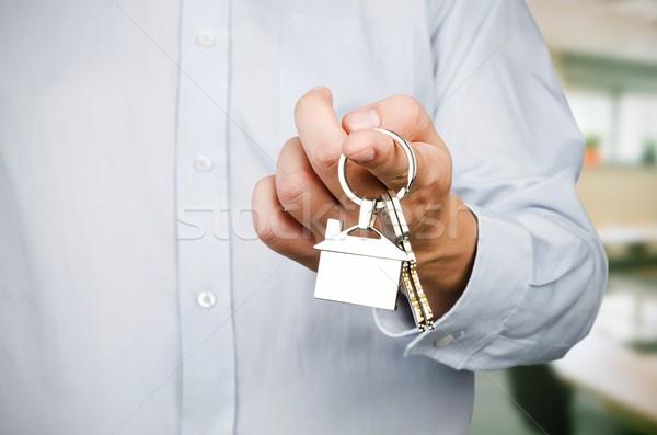 Estate agent holding keys to new house Stock photo © simpson33