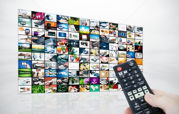 Big LCD panel with television stream images and remonte control  Stock photo © simpson33