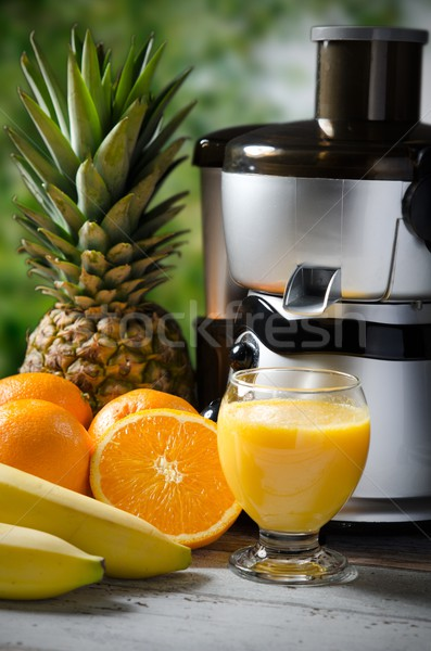 Fresh juice and juicer. Photo on wooden background  Stock photo © simpson33