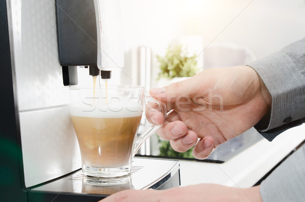 Home professional coffee machine with capuccino cup Stock photo © simpson33