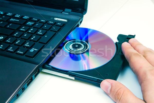 Man compact disc laptop kantoor muziek hand Stockfoto © simpson33