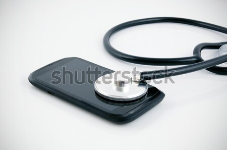 Smartphone diagnose by stethoscope. Medical concept Stock photo © simpson33
