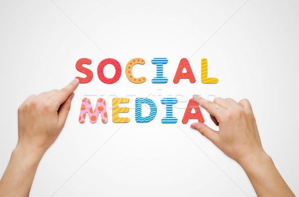Hands put the words Social Media with magnetic letters Stock photo © simpson33