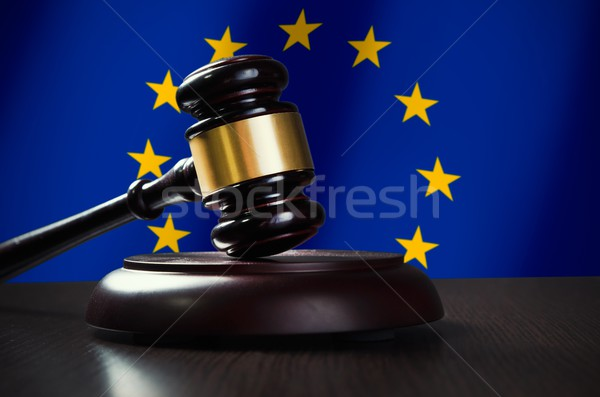 Wooden gavel with European Union flag in background Stock photo © simpson33
