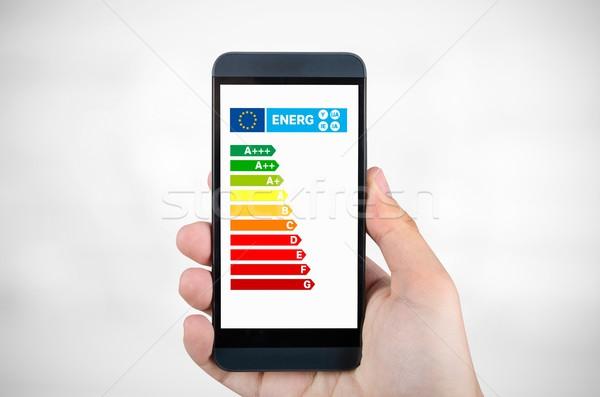 Homme smartphone efficacité énergétique graphique économies Photo stock © simpson33
