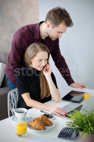 Couple working with laptop in home. Stock photo © simpson33