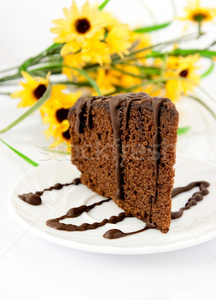 Stock photo: Gingerbread on plate, yellow flowers in background