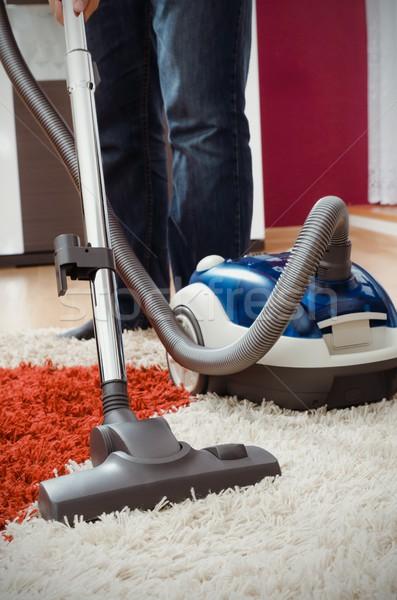 Férfi kócos szőnyeg lakás modern kék Stock fotó © simpson33