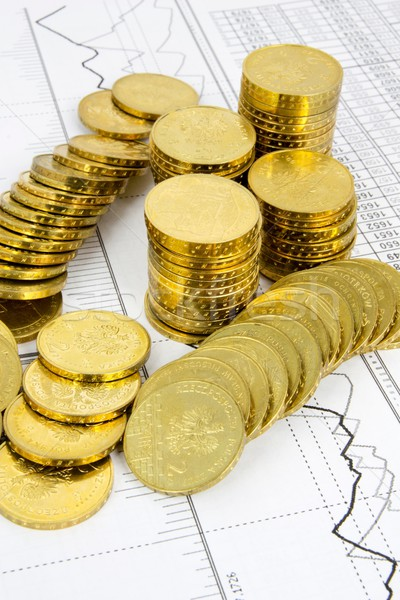 Golden coins concept on business background Stock photo © simpson33
