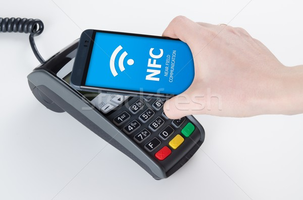 Mobile payment with NFC near field communication technology Stock photo © simpson33