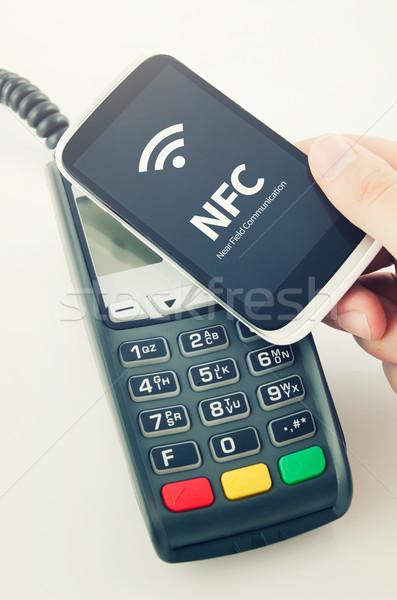 Betaling kaart chip hand telefoon Stockfoto © simpson33