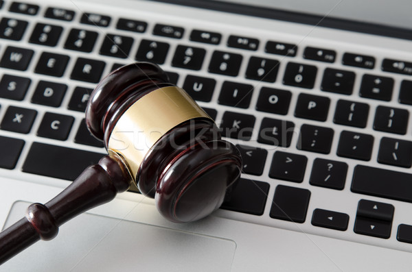 Wooden gavel on laptop keyboard Stock photo © simpson33