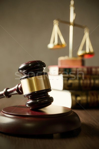 Wooden gavel and books on wooden table Stock photo © simpson33