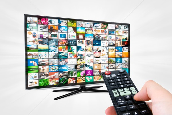 Widescreen high definition TV screen with video gallery. Remote  Stock photo © simpson33