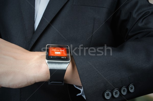 Businessman receives message notification on smart watch Stock photo © simpson33