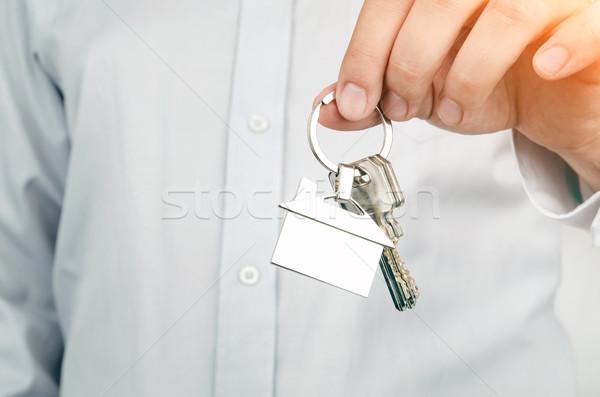 Estate agent holding keys to new house Stock photo © simpson33