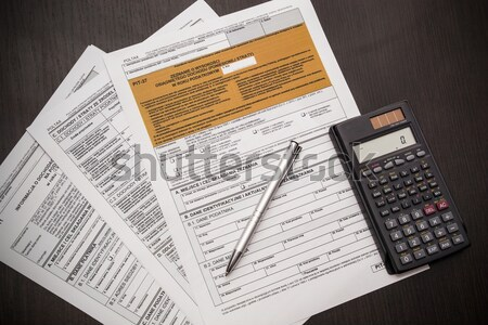 Polish tax form with pen and calculator on desk Stock photo © simpson33