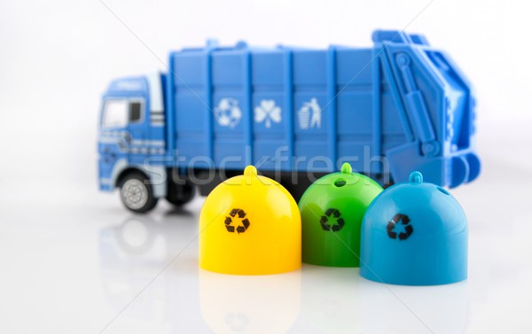 Colored trash bins and garbage truck toys on white background Stock photo © simpson33