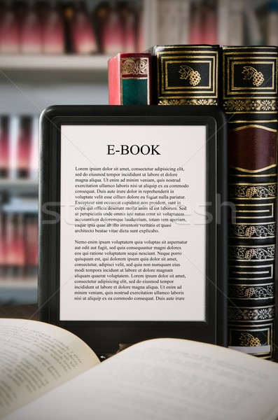 E-book reader device on desk in library Stock photo © simpson33