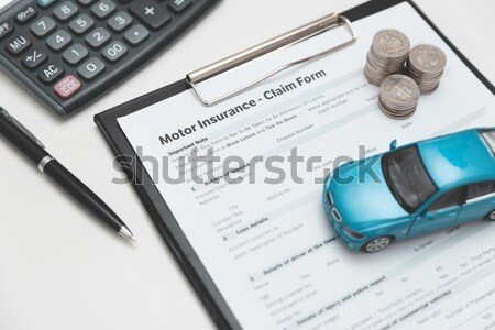 Car toy and keys on insurance documents . Protection car concept Stock photo © simpson33