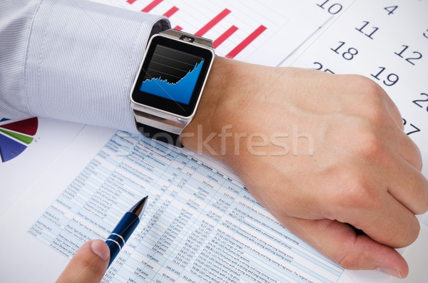 Man working with smart watch in office Stock photo © simpson33