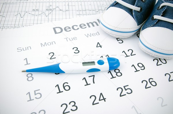 Electronic thermometer in fertility concept on calendar Stock photo © simpson33