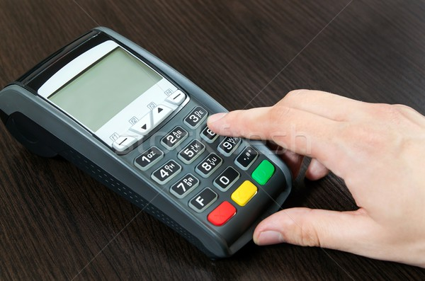 Man hand using payment terminal in shop Stock photo © simpson33