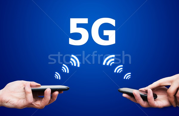 Mobile devices with 5G network standard communication Stock photo © simpson33