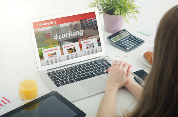 Woman using laptop in home. Culinary website blog concept Stock photo © simpson33