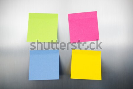 Close up of coloured reminders on fridge. Metallic background wi Stock photo © simpson33