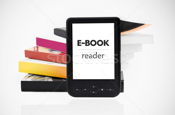 Modern e-book reader with books in background Stock photo © simpson33