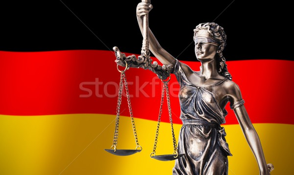 Themis with scale, symbol of justice on German flag background Stock photo © simpson33