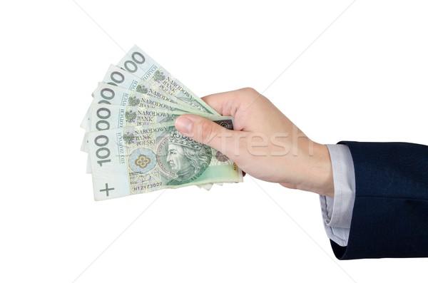 Alcance notas mão dinheiro moeda isolado Foto stock © simpson33