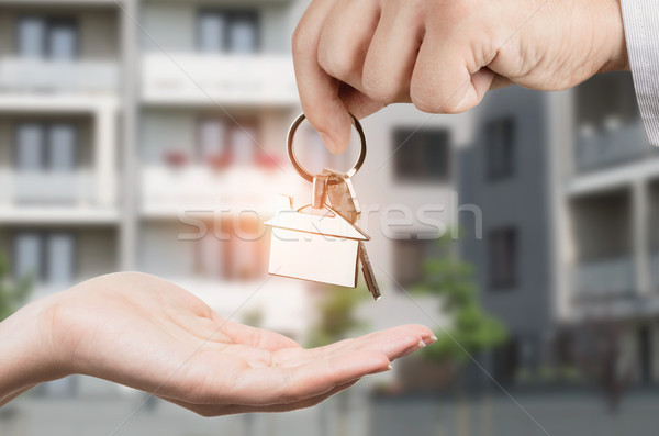Man gives a woman the keys to a new home Stock photo © simpson33