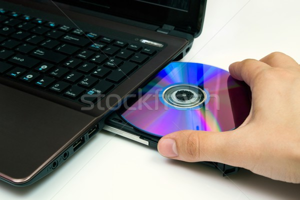 男 コンパクトディスク ノートパソコン オフィス 音楽 手 ストックフォト © simpson33