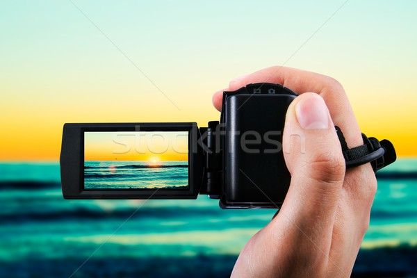 Video camera or camcorder recording sunset Stock photo © simpson33