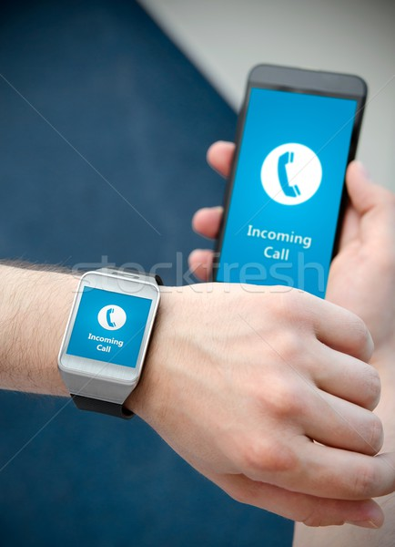 Incoming call notification on smart watch connected to smart pho Stock photo © simpson33