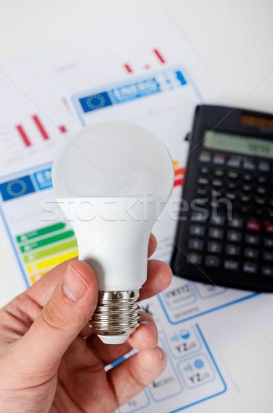 手 電球 エネルギー効率 グラフ 電卓 ストックフォト © simpson33