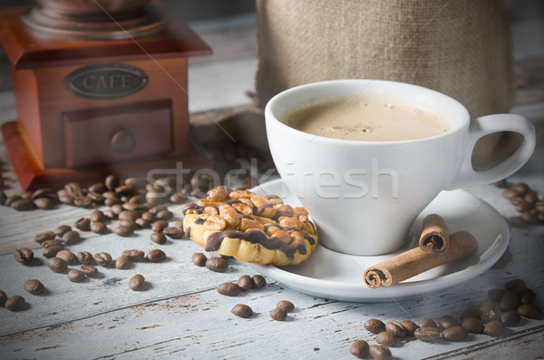 Coffee, roasted beans, mill grinder and some sweets Stock photo © simpson33
