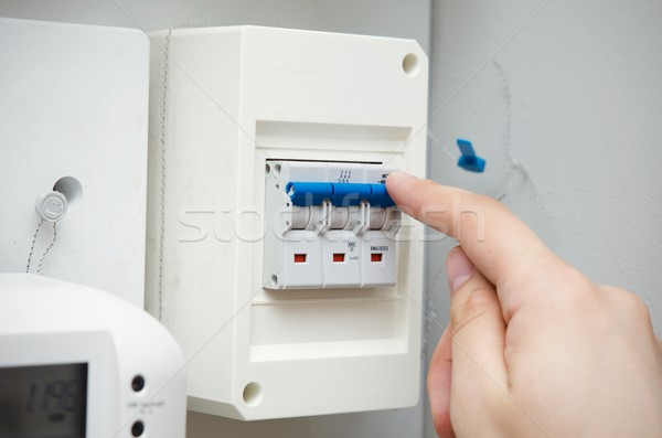 Man switches automatic fuse. Electric equipment close up Stock photo © simpson33