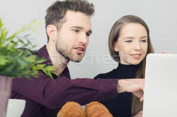 Couple cooperates with the computer in the office Stock photo © simpson33